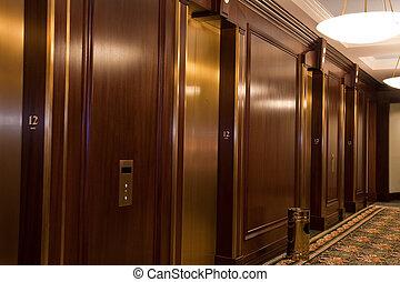 Twelth Floor Elevator Lobby - A wood and brass elevator ...