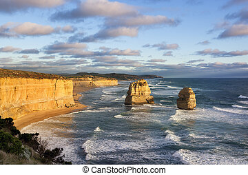 Twelve Apostles in Victoria, Australia, approaching sunset. Two of the famous rock stacks.