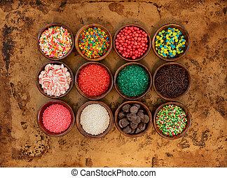 Twelve Bowls of Sprinkles in Wooden Bowls