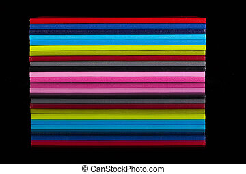 Twelve different color diaries on a black glass table