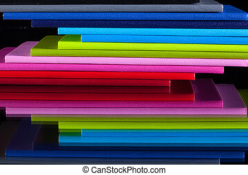 Twelve different colors diaries on a glass desk