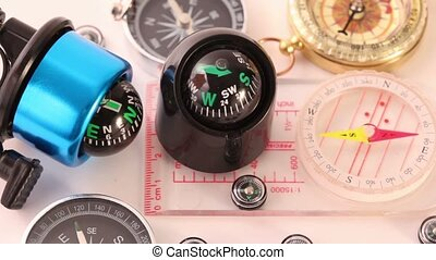 Twelve different multi-colored compasses