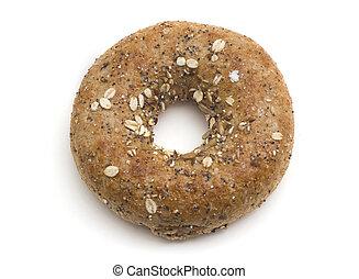 Single twelve grain bagel isolated on white.
