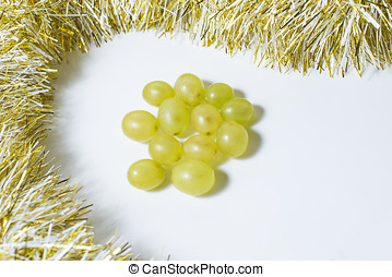 Twelve grapes, that are eaten in Spain to celebrate the new year