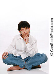 Twelve year old boy sitting, thinking
