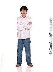 Twelve year old boy standing