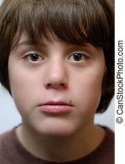twelve year old boy with big brown eyes