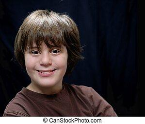 twelve year old boy with big smile