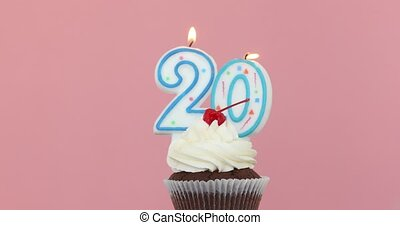 Twenty 20 candle in cupcake pink background - Number Twenty...
