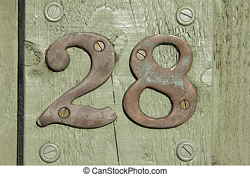 Twenty eight - Metal number 28 on green painted front door