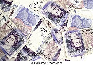Twenty pound notes - Twenty pounds sterling notes on a white...