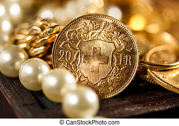 Twenty Swiss Francs gold coins - Selective focus