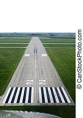Twenty Two - Looking down the runway of a rural airport.