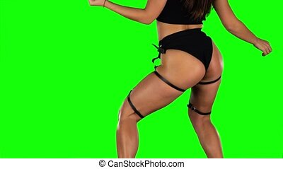 Twerking young woman. Green