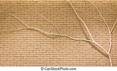 Twig on brick wall