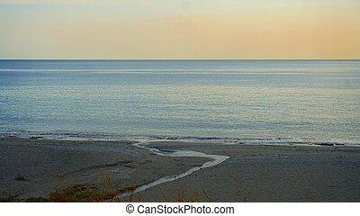 twilight on a beautiful empty beach, the end of the season