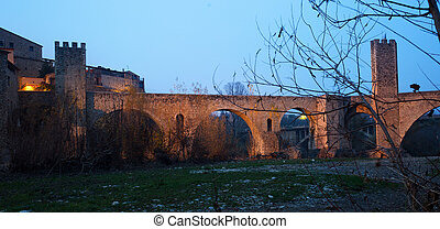twilight photo of Medieval bridge. Besalu, Catalonia