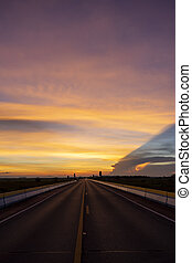 Twilight sky with silhouette of the road.