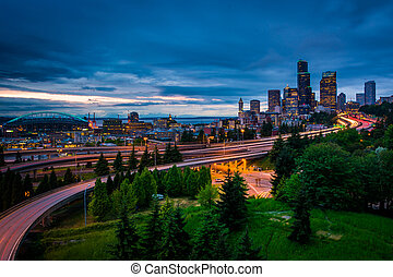 Twilight view of the Seattle skyline from the Jose Rizal Bridge, in Seattle, Washington.