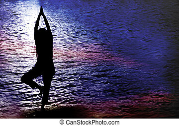Twilight Yoga - A hindu woman practicing Yoga near a lake in...