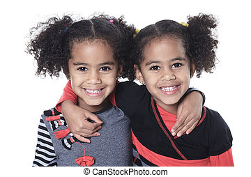 Twin adorable african little girl with beautiful hairstyle isola