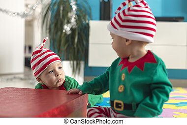 twin babies elf helper of Santa