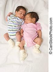 Portrait of twin babies boy and girl
