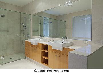 Modern, stylish twin bathroom