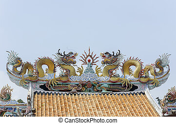 Twin dragon statue on the roof in chinese temple.
