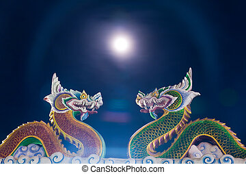 Twin dragon statue with moon