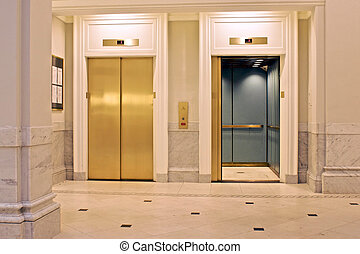 twin elevators - facing twin elevators on first floor, one...