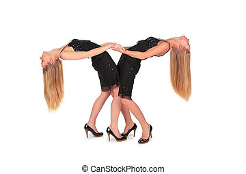 Twin girls bend behind