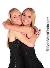 Twin girls embracing