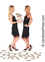 Twin girls holding Dollars 2