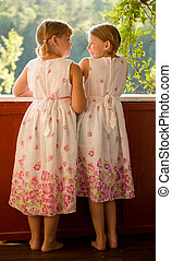 Twin girls in summer dresses