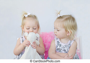 Twin Girls Learning to Share