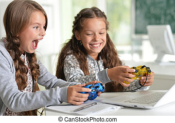 Twin girls playing