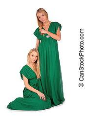 Twin girls: sitting near sister