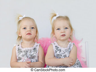 Twin Girls - Twin Little Girls Looking Serious