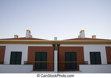Twin Houses - a detail of twin houses in a village ready to...