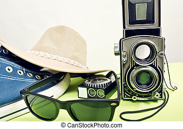 twin-lens reflex camera with sneaker and sunglasses
