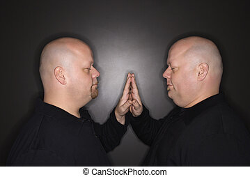 Twin men siblings. - Caucasian bald mid adult identical twin...