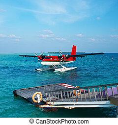 Twin otter seaplane at Maldives - Twin otter red seaplane at...