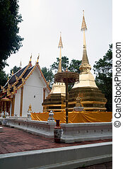 Twin Pagoda of Phra That Doi Tung. - Twin golden Pagoda on...