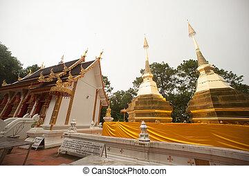 Twin Pagoda of Phra That Doi Tung. - Twin golden Pagoda on...