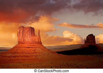 Twin peaks of rock formations in the Navajo Park of Monument Valley Utah