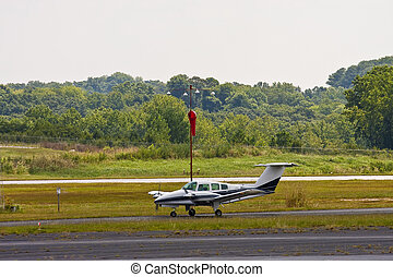 A private twin prop plane landing at a small airport
