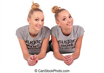 twin sport girls lying 2