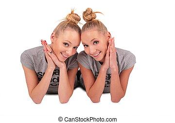 twin sport girls lying 3