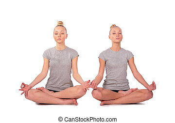 Twin sport girls meditating